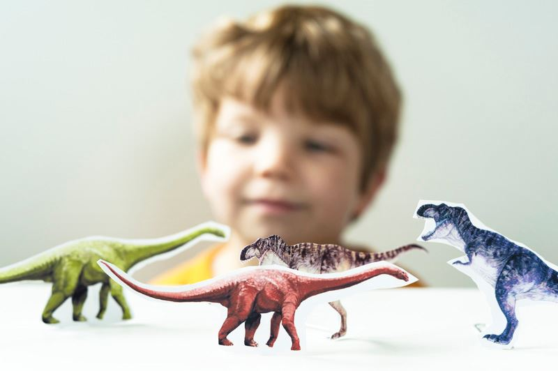 Child and Dinosaurs